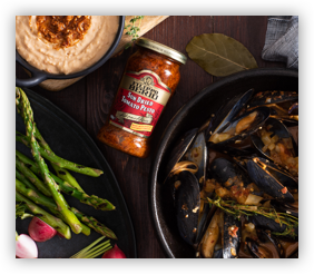 Sun Dried Tomato Pesto Surrounded by Hummus, Asparagas and Mussels