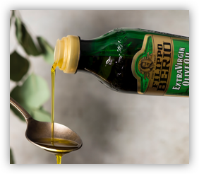 Extra Virgin Olive Oil Pouring on a Spoon